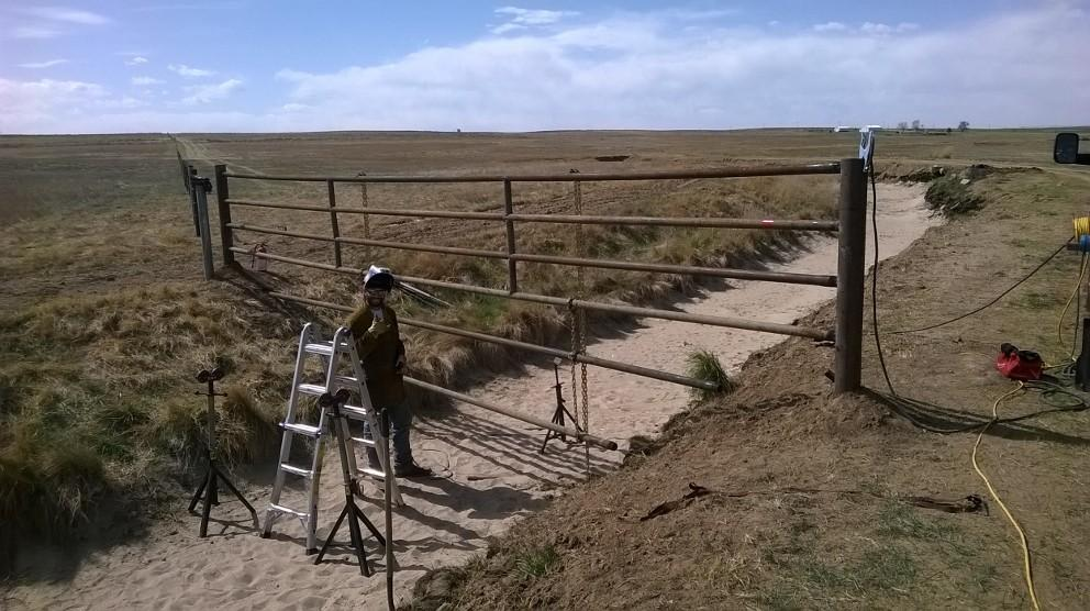 Pipe Fence Construction over an Irrigation Ditch